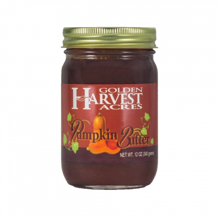 "A glass jar with gold lid. The jar is full of a brown spread. An orange label shows a two halves of a butternut squash and vining leaves. The label reads ""Golden Harvest Acres Pumpkin Butter Net Wt. 12 oz (340 grams)"""